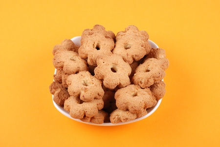 The cookies on yellow background photo