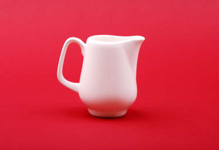 milk jug: milk jug on red background