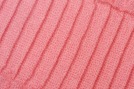 knitten: Close-up pink knitted background.