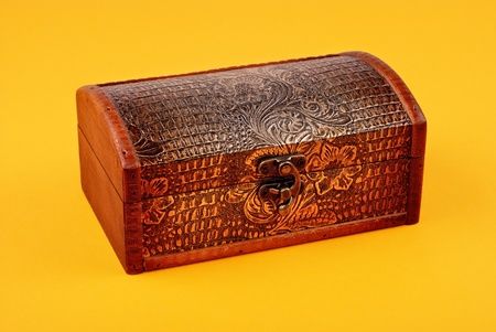 wooden decorative casket on yellow background photo