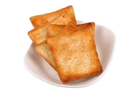 comiendo pan: tostadas de pan en un plato aislado