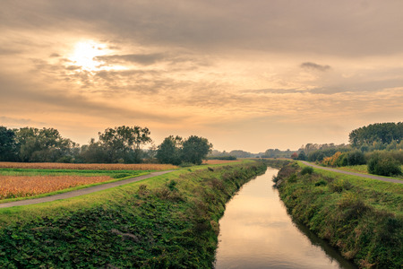 demersal: A river runs between 2 towpaths through the Flemish countryside in the autumn