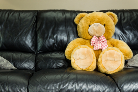 Big Brown Teddy Bear Sitting In Black Sofa Stock Photo   81759565