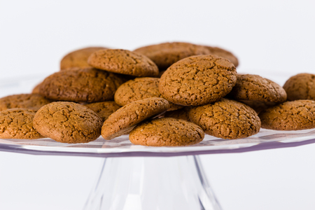 pile of homemade speculaas (type of spiced biscuit made of brown sugar & cinnamon) for the St Nicholas day (Sinterklaas) on white background Stock Photo