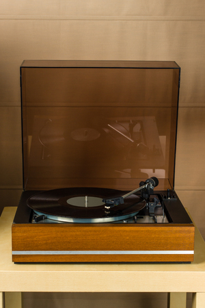 Vintage turntable playing a vinyl record Stock Photo