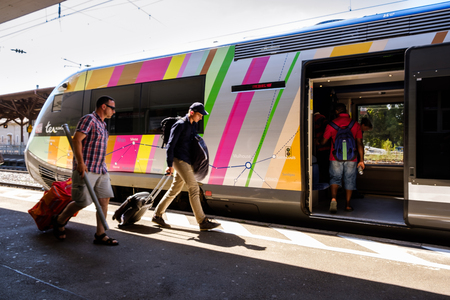 Mullheim, Baden-Wurttemberg, Germany - JULY 30 2018 : Passengers onboarding on the TER Alsace regional train of the French Railways (SNCF) in the Mullheim railway station