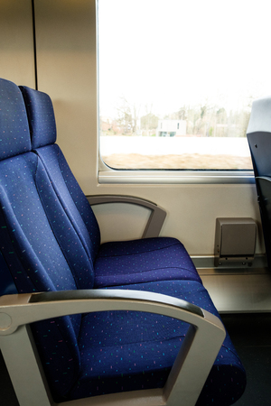 Two empty blue train seats, public travel concept