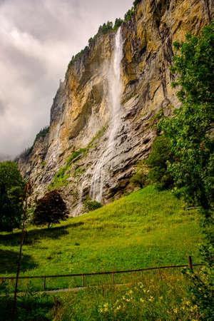 Famous Staubbach Falls in the Lauterbrunnen valley, Jungfrau region, Bernese Oberland, Switzerland, overcast day in summer. Portrait orientation Reklamní fotografie