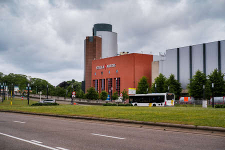 Leuven, Vlaams-Brabant, Belgium - May 30 2019: Dark clouds hanging over the Stella Artois brewery and AB Inbev headquarters. Editorial