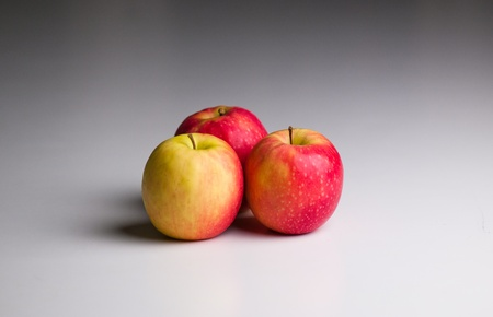 Three Apples on a gradient grey background