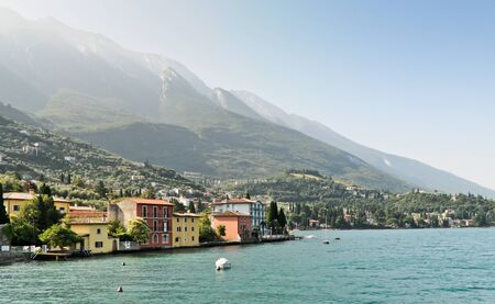 Malcesine from the lake with mountain slopes in the background