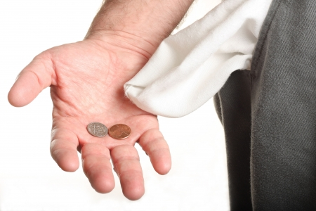 Man with coins in palm and empty pocket photo