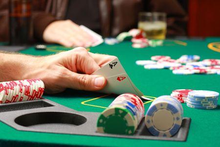Man checking cards during poker game photo