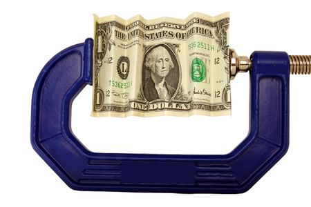 Financial or economic metaphor:  dollar bill in clamp Stock Photo - 3022492