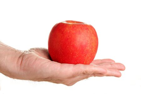 Man holding delicious red apple, isolated on white Stock Photo