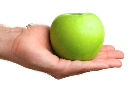Man holding delicious green apple, isolated on white