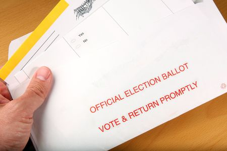 Man open ballot he got in the mail Stock Photo