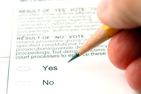 ballot papers: Person filling out ballot, shallow depth of field