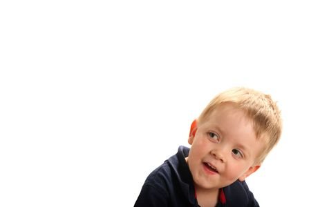 Cute smiling boy with blonde hair and green eyes looking up, isolated on white Stock Photo - 3354959