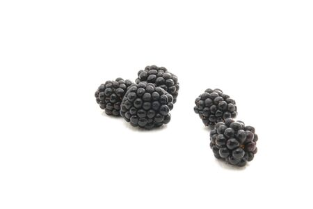Group of plump, juicy blackberries ready to eat, isolated on white Stock Photo