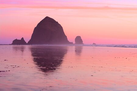 Beautiful sunset at Haystack Rock, Cannon Beach, Oregon Stock Photo