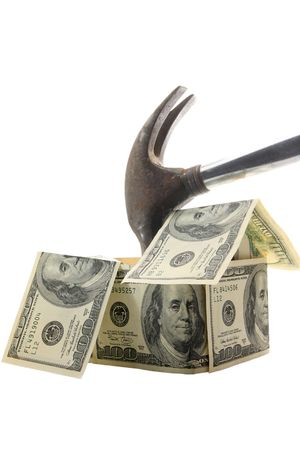 Hammer smashing house made of $100 bills - financial metaphor for home mortgage crisis Stock Photo