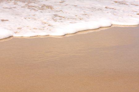 Beautiful white surf washing up on the beach