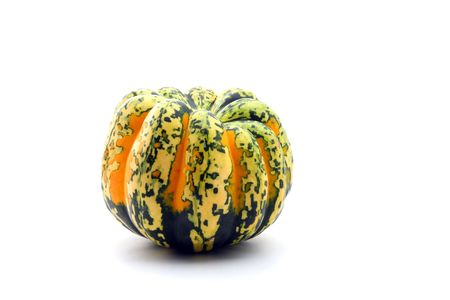 Colorful autumn orange and green squash isolated on white