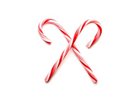 Two red and white Christmas candy canes, isolated on white