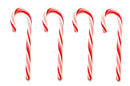 Four red and white Christmas candy canes isolated on white