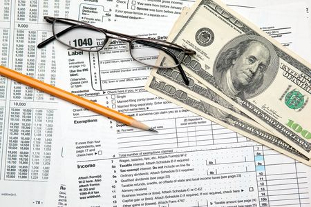 Tax time - Closeup of U.S. 1040 tax return with pencil and glasses