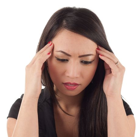 Worried attractive young asian woman with headache, head in hands photo