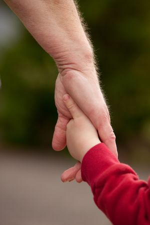 Mature woman holding hands walking with with young child Stock Photo - 6902548
