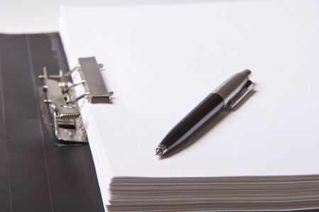 pen on file folder with paper for office photo