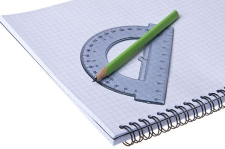 contracting: protractor and pencil on copybook  isolated on the white background