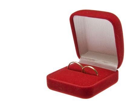 Two golden wedding rings in open red box isolated on white background photo