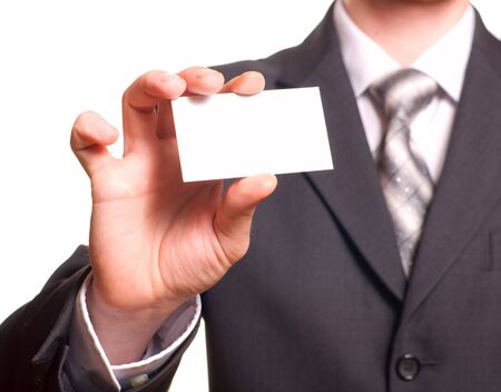 holding credit card: Business man handing a blank business card over white