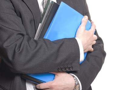 business man holding stack of files and folders photo
