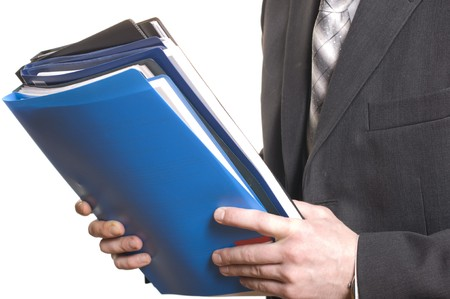 business law: business man holding stack of files and folders