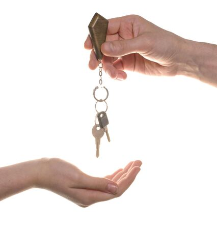 business man give to woman a key isolated over white