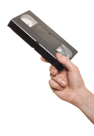 Hand with video cassette isolated over white Stock Photo