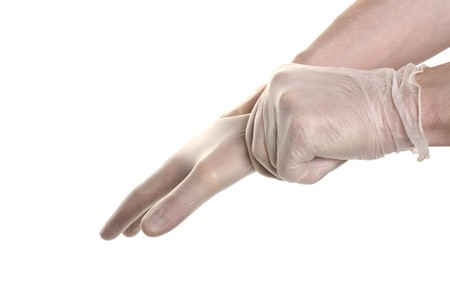 proctologist: Doctor pulling on surgical glove isolated over white