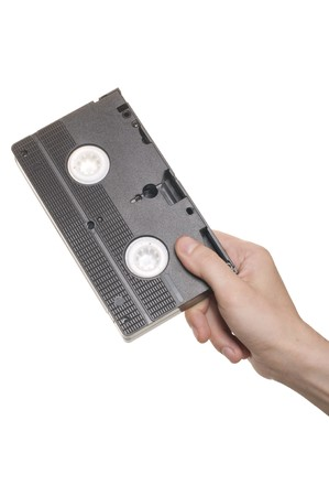 Hand with video cassette isolated over white  photo