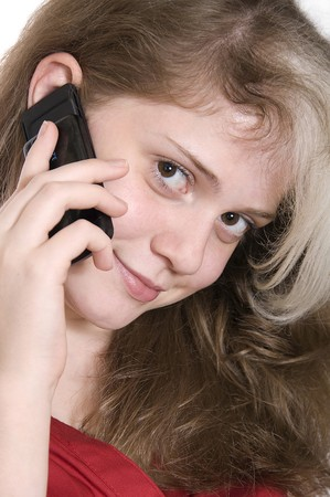beautiful young girl in red with a mobile phone
