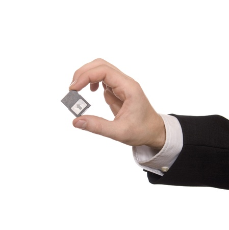 digital memory: Businessman holding a Secure Digital Memory Card Stock Photo