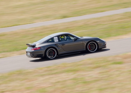 motorsports: Fast car in a race Editorial