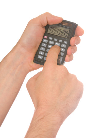 mans hand and a calculator