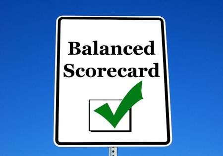 marked: balanced scorecard process check marked on a white road sign