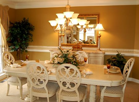 beautifully decorated dining room in a luxury model home Stock Photo