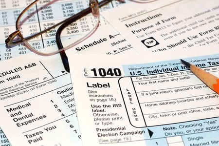 federal tax forms with pencil and glasses Stock Photo